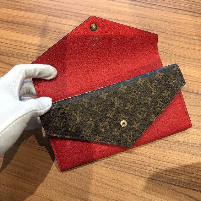 十三のお客様からヴィトンの新品の財布【ポルトフォイユ・ドゥブルV】を買取_02