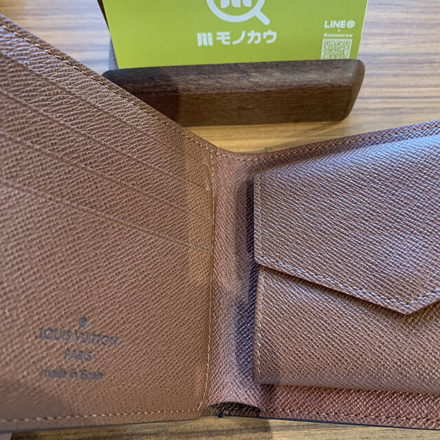 十三のお客様からヴィトンの二つ折り財布を買取_04