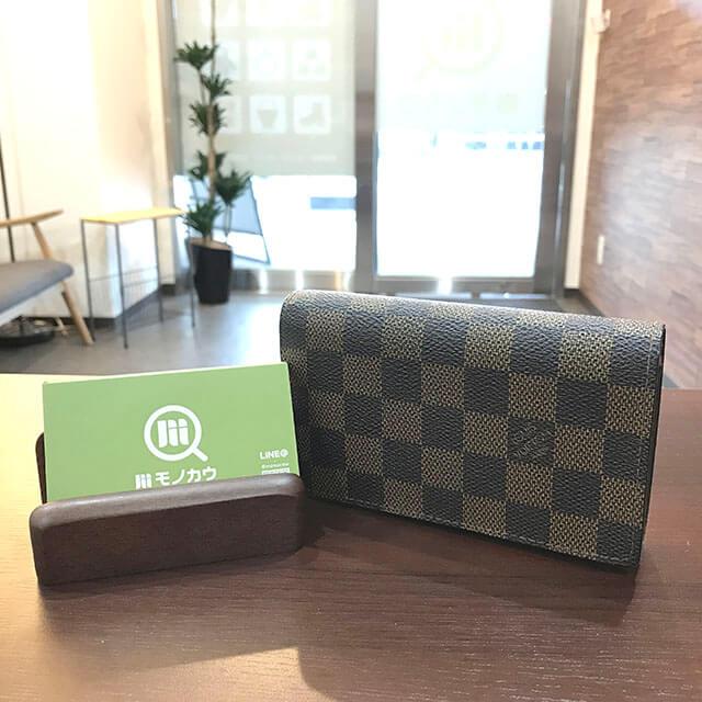 箕面のお客様からヴィトンの財布【トレゾール】を買取_01