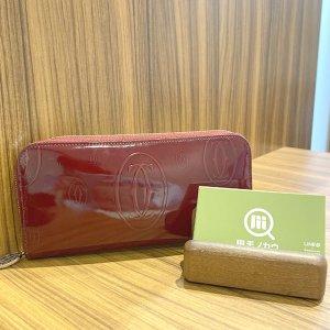 放出のお客様からカルティエの長財布【ハッピーバースデー】を買取